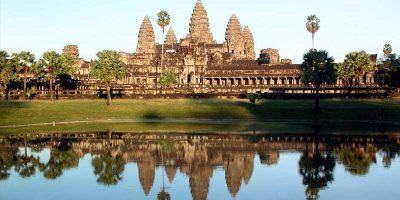 Watch the sun rise majestically over Angkor Wat's spires